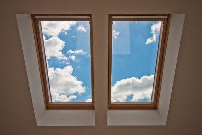 Fotomural Claraboyas Vista desde la ventana. Vista del cielo desde la ventana. Ventana en el techo. La luz del sol a través de la ventana del ático. Luz en la casa