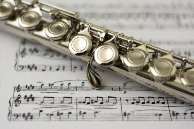 Fotomural Close up flute on flute sheet music background