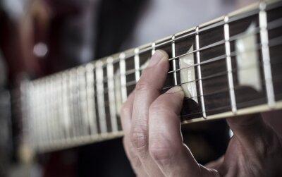 Fotomural Dedos Sobre diapasón de guitarra