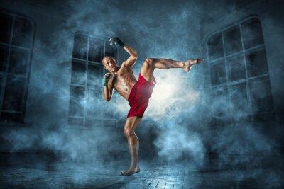 Fotomural El hombre joven kickboxing