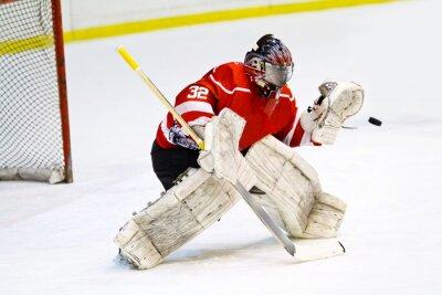 Fotomural El portero del hockey en equipo rojo genérico protege la puerta