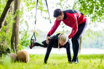 Fotomural Fitness y deportes - pareja haciendo Slingtraining