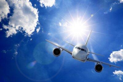 Fotomural Flugzeug en Sonne und Wolken