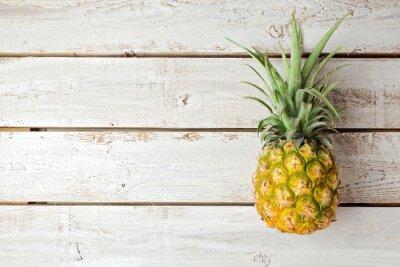 Fotomural Fondo de verano con la piña en la tabla de madera