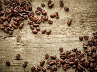Fotomural Granos de café en la mesa de madera