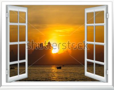 Fotomural Hermosa puesta de sol en el mar vista desde la ventana con cortinas abiertas
