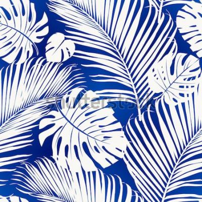 Fotomural Hojas de patrones sin fisuras con siluetas blancas de palmera sobre fondo azul.