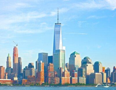Fotomural Horizonte de la ciudad de Nueva York Bajo Manhattan edificios del distrito financiero de Wall Street en un hermoso día de verano con el cielo azul