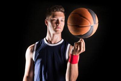 Fotomural Jugador de baloncesto de girar pelota en el dedo