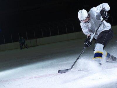 Fotomural jugador de hockey sobre hielo en acción
