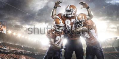 Fotomural Jugadores de fútbol americano en acción en vista panorámica del estadio