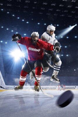 Fotomural Jugadores de hockey disparan el puck y los ataques