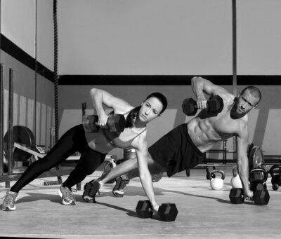 Fotomural La fuerza de flexión de brazos de plancha Gimnasio hombre y mujer