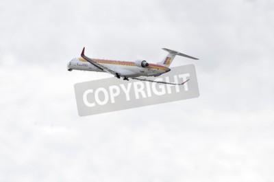 Fotomural MADRID, ESPAÑA - 14 DE JUNIO DE 2015: Avión -Bombardier Canadair CRJ-1000-, de -Air Nostrum-, despega desde Madrid-Barajas -Adolfo Suárez-, el 14 de junio de 2015.