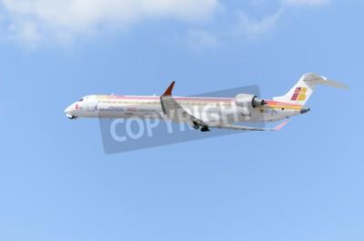Fotomural MADRID, ESPAÑA - 14 DE JUNIO DE 2015: Avión -Bombardier Canadair CRJ-900-, de -Air Nostrum-, despegará desde Madrid-Barajas -Adolfo Suárez-, el 14 de junio de 2015.