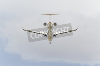 Fotomural MADRID, SPAIN - FEBRUARY 14th 2015: Aircraft -Bombardier CRJ-900-, of -Iberia- airline, is landing on Madrid-Barajas -Adolfo Suarez- airport, on February 14th 2015.