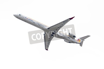 Fotomural MADRID, SPAIN - MAY 3th 2015: Aircraft -Bombardier Canadair CRJ-1000-, of -Air Nostrum- airline, is taking off from Madrid-Barajas -Adolfo Suarez- airport, on May 3th 2015.