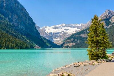 Fotomural Majestuoso lago de montaña en Canadá. Vista del lago Louise en Banff, Alberta, Canadá. Montañas Rocosas.