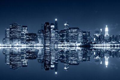 Fotomural Manhattan en la noche con reflexiones sobre el río Harlem