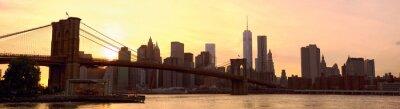 Fotomural Manhattan skyline panorama con el puente de Brooklyn al atardecer, Nueva York, Estados Unidos