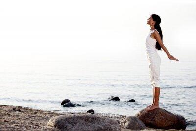 Fotomural meditación sobre la arena de la playa