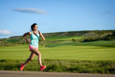 Fotomural Mujer deportiva correr rápido en la carretera de campo. Mujer al aire libre de entrenamiento del atleta.