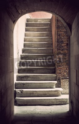Fotomural Mysterious ancient empty staircase in sepia
