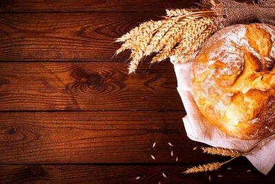 Fotomural Pan hecho en casa sobre fondo de madera. Estilo rústico. Fondo de la hornada del alimento
