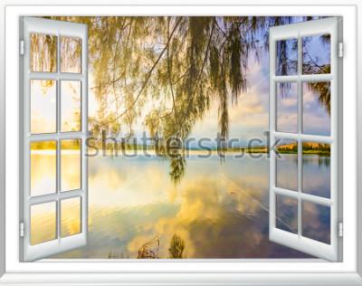 Fotomural Paraíso con vista al mar desde la ventana en la isla del soleado día de verano