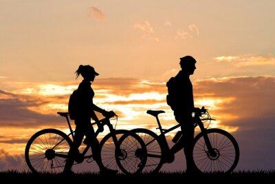 Fotomural Pareja con la bici al atardecer