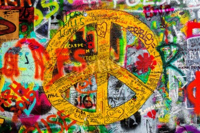 Fotomural PRAGUE, CZECH REPUBLIC - MAY 21, 2015: Peace Sign on Famous John Lennon Wall on Kampa Island in Prague filled with Beatles inspired graffiti and lyrics since the 1980s.
