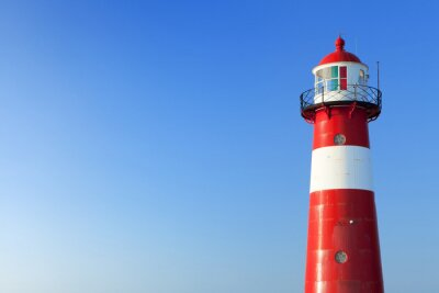 Fotomural Red and white lighthouse and a clear blue sky