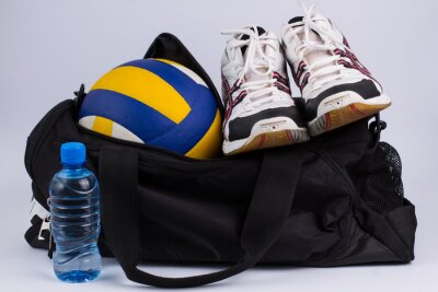 Fotomural Sports bag with sportswear and ball.