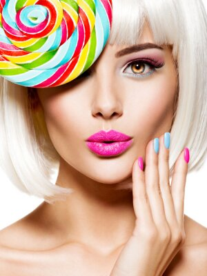 Fotomural Surprised face of a pretty woman  with multicolor nails and pink lips