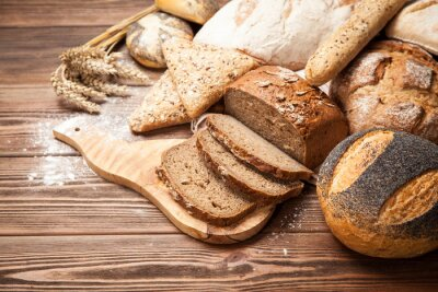 Fotomural Surtido de pan en superficie de madera