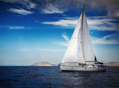 Fotomural The white sails of yachts on the background of sea