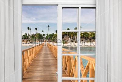 Fotomural Ventana abierta vista del mirador en el mar.