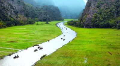 Fotomural Vietnam paisaje de viaje. Río torcido y montañas de Tam Coc Ninh Binh