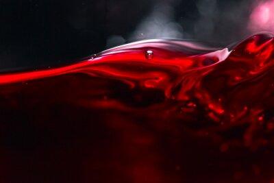 Fotomural Vino tinto sobre fondo negro