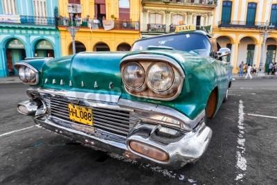 Fotomural Vintage coche en un barrio colorido en La Habana