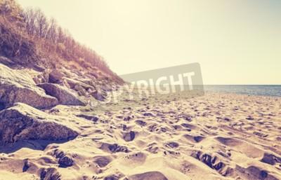 Fotomural Vintage entonado imagen de una playa al atardecer.
