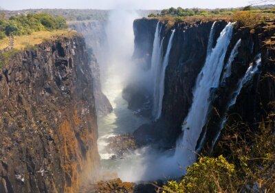 Fotomural Vista de las Cataratas Victoria desde el suelo. Parque Nacional Mosi-oa-Tunya. Y Patrimonio de la Humanidad. Zambiya. Zimbabue. Una excelente ilustración.