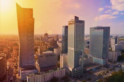 Fotomural Warsaw downtown - aerial photo of modern skyscrapers at sunset