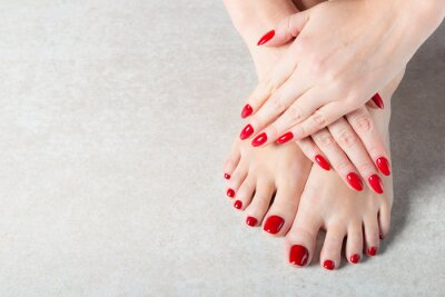 Fotomural Young lady is showing her red manicure nails
