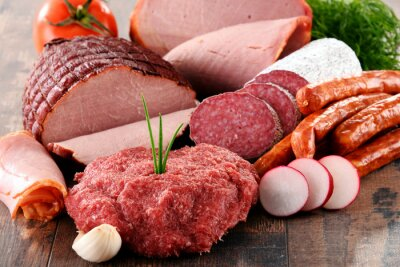Póster Assorted meat products including ham and sausages