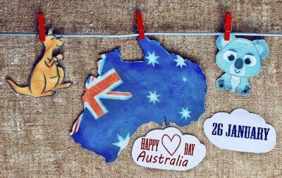 Póster Australia día Concepto - saludo escrito en blanco australiano mapas, canguros y koala - colgando clavijas (pinza de ropa), 26 de enero. Imagen entonada. efecto de la luz solar
