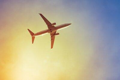 Póster Avión de la puesta del sol
