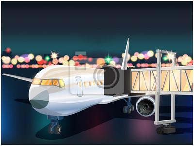 Avión y aeropuerto por la noche