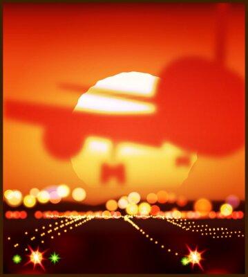Avión y el sol poniente
