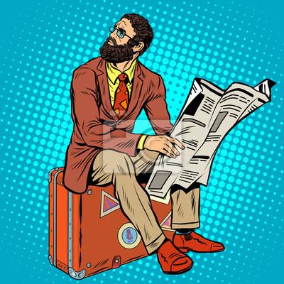 Barba de viajero hipster leyendo un periódico